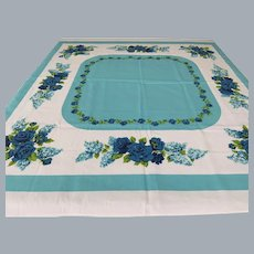 """Vibrant turquoise and royal blue roses tablecloth 50""""- vintage  but unused"""