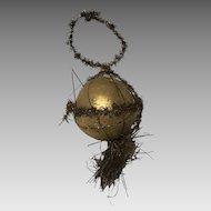 Vintage Christmas ornament papier mache ball wrapped tinsel.
