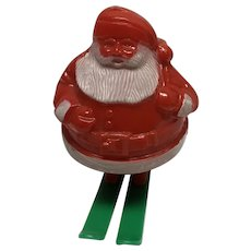 Vintage hard plastic Christmas candy container Santa on skis