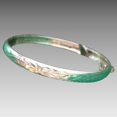 Child's sterling silver antique etched hinged bangle bracelet