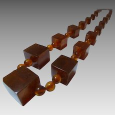 Bakelite cube and beads graduated apple juice necklace