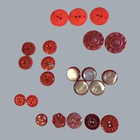 Lot 22 Vintage celluloid + plastic red buttons