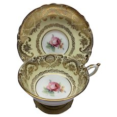 Vintage Paragon yellow cup and saucer gold guilt pink rose