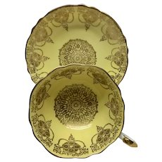 Paragon cup and saucer set yellow and gold