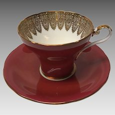 Ruby red Aynsley corset cup and saucer set with lots of gold