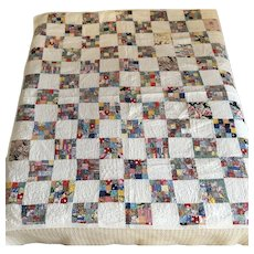 Postage stamp reversible hand quilted 1960's 16 piece per square pattern cotton floral quilt
