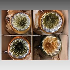4 large indented gold and silver coloured Christmas ornaments