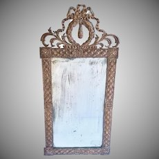 Early 19th Century French Neoclassical Silvered Repousse Mirror Bow and Wreath Motif