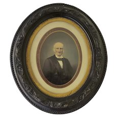 Late 19th Century Oval Frame with Flower Motif and Photograph of a Man