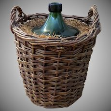 French 1900's Demijohn Bottle in Woven Grape Vine Basket