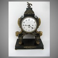 French Ebonized Empire Mantel Clock