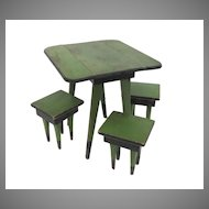 Painted Folk Art Child's Drop-leaf Table and Four Matching Stools.