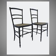 Pair Ebonized and Gilt Pin Striped Side Chairs Caned Seats