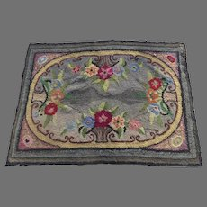 American Hooked Rug with basket and flowers