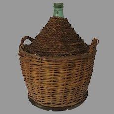 Vintage French Demijohn Bottle in Woven Basket