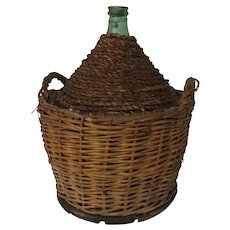 Vintage French Demijohn Bottle in Woven Basket