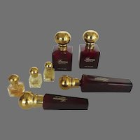 Seven Collectible Ralph Lauren Red and Gold Cologne Bottles and Three Miniature Bottles