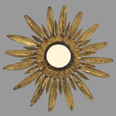 Mid-Century Hollywood Regency Gilt Metal Sunburst Light Fixture With Mirror Glass Center