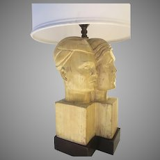 Art Deco Carved Two Head Table Lamp on a Ebony Base