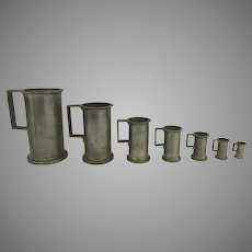 Set of Seven French Graduated Pewter Measures M.672