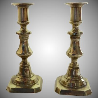 Pair of English 19th Century Push Up Brass Candlesticks