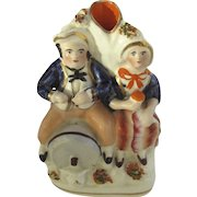 19th Century Staffordshire Figure of Man and Wife Toby Sitting on Beer Barrel