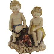 Vintage Porcelain Figure of Two Children Tending a Campfire