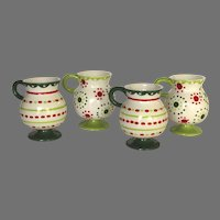 Group of Four (4) Pottery Christmas Chocolate Cups
