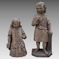 Pair of Stone Carvings of Boy and Girl