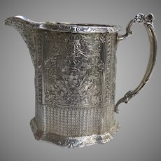 Large 1900's E.G. Webster & Son Silver Plated Water Pitcher Repousse Dutch Theme Windmill Crowned Man