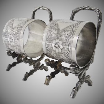 Two Silver Plated Napkin Rings Standing on Faux Bois Legs Aesthetic