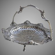 Silver Plate Swing-Handle Basket w/Medallions/Women's Faces with Hooved-Foot Griffin Handle circa 1890 American