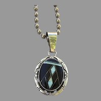 Signed Vintage Native American Jewelry Pendant by Navajo silversmith Phillip Sanchez Inlaid Onyx Opal