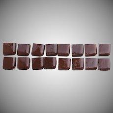 Group of 16 Brown Glazed Tile Corners