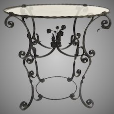 Vintage Garden Glass Top Wrought Iron Table with Center Bouquet of Flowers