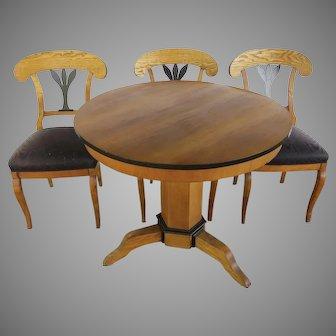 Table and Three Biedermeier Chairs 19th Century