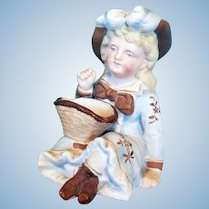 Bisque Girl Figurine with Basket