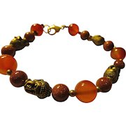 """Bronze Buddha Charms Mixed with Golden Sandstone and Orange Agate Bead Bracelet, 8"""""""