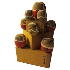 "3 7/8"", Eight Auspicious Daruma Kokeshi Dolls on Three Boxes"