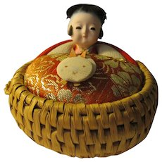 """3 1/4"""", """"Eji-ko"""" Kokeshi Doll in Woven Rice Basket"""