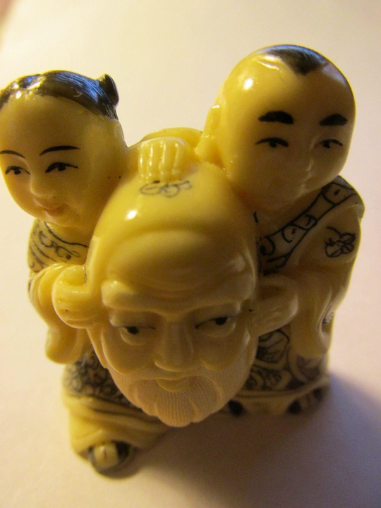 Carved Resin Bone Netsuke Collectible Pendant Of Girl And Boy Holding Eurasian Collectibles Ruby Lane