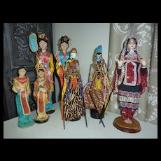 7 Indonesian and Oriental Dressed Dolls