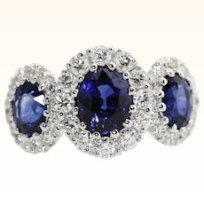 Natural Velvet Blue Sapphire and Diamond Ring 2.35 Carats TW  18K White Gold Estate Earth Mined Halo Diamond ring Spark Jewelers