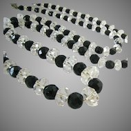 Long Graduated Faceted Rock Crystal and Black Glass Necklace 32 Inches