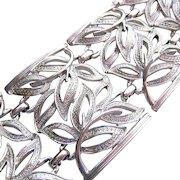 Coro Pegasus Wide Silver Tone Bracelet Lacy Foliate Design Open Work
