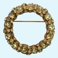 Signed Warner Green Sparkly Rhinestone Wreath Brooch