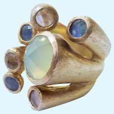 Fascinating Silver Tone Ring with Multi-Colored Stones Likely Aluminum