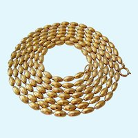 Vintage 1962 Napier Gold Tone Textured Bead Necklace 60 Inches Book Piece