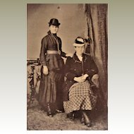 Tintype Photograph- Two Young Ladies -One wears Bowler Hat- The other a Military Coat.