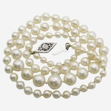 Art Deco Cultured Pearl Necklace With 14K White Gold Diamond Clasp.